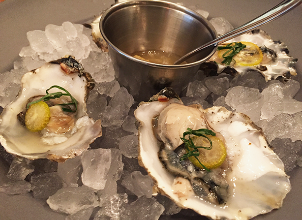 Freshly shucked oysters with Korean pear, citrus, soy, and perilla