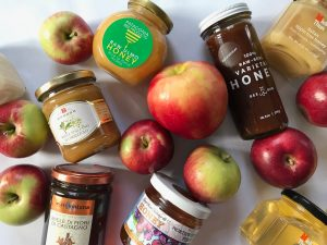 jars of honey and apples