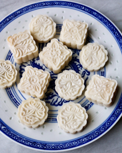 moon cakes on a blue plate
